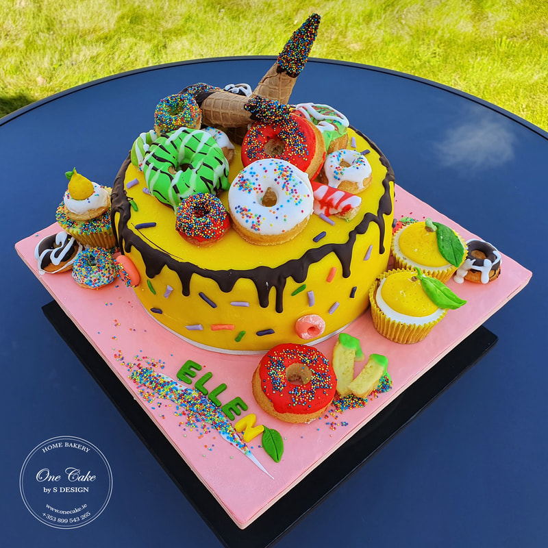 Chocolate cake with lemon donuts and cupcakes